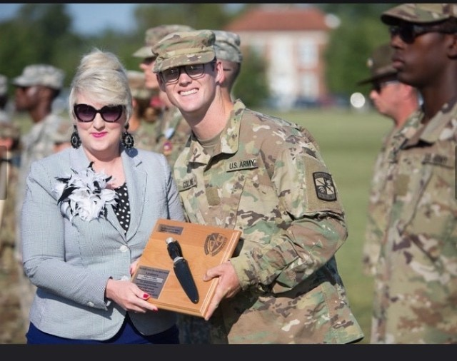 Cadet William Collins receives the Bold Leader Spirit Award, during his Advanced Camp graduation in Fort Knox, Ky.