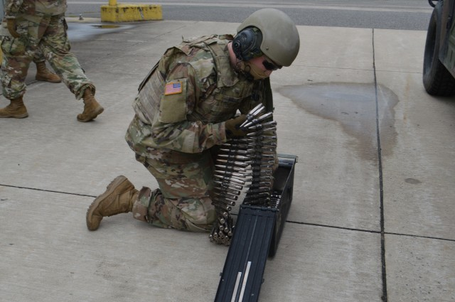 Pfc. Alexander Miller, 5th Battalion, 4th Air Defense Artillery Regiment, 10th Army Air & Missile Defense Command, air and missile defense crewmember, loads M3P .50 caliber machine gun ammunition into a magazine on Shipton Kaserne Apr. 30 prior to conducting training. The crews are maintaining their combat proficiency in a COVID-19 environment.