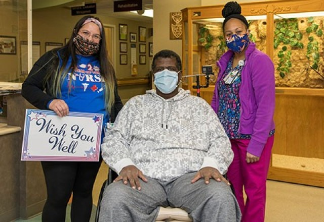Arvin McCray poses with his health care team before they took him from the 9th floor to the south entrance where he was discharged today after spending 50 days in the hospital.