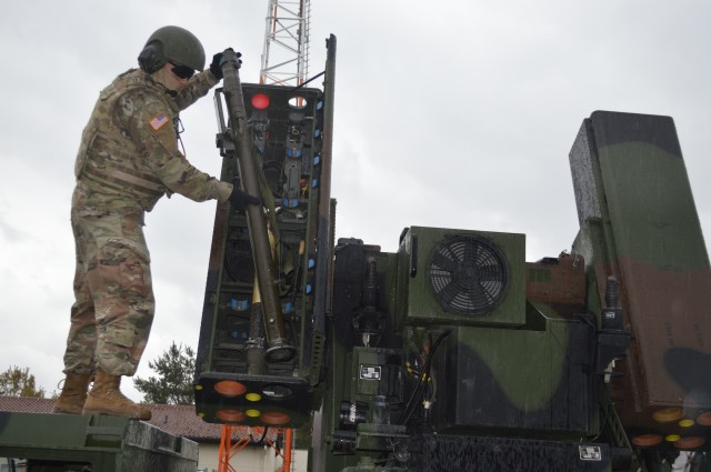 Pfc. Alfredo Benitez, 5th Battalion, 4th Air Defense Artillery Regiment, 10th Army Air & Missile Defense Command, air and missile defense crewmember, loads a Stinger missile onto an Avenger short-range air defense missile system on Shipton Kaserne Apr. 30 during training. The crews are maintaining their combat proficiency in a COVID-19 environment.