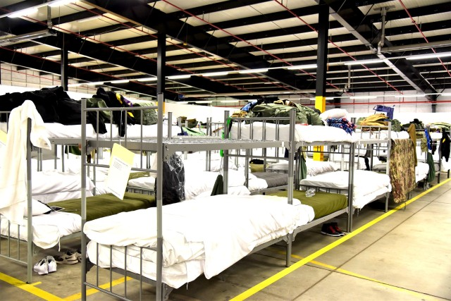 Bunk beds stand six feet apart in the US Army Garrison Rheinland-Pfalz Deployment Processing Center. Advanced Individual Training Soldiers on their way to their assignments throughout Germany are being housed by USAG RP for their 14 day quarantine period, as required by the host nation.