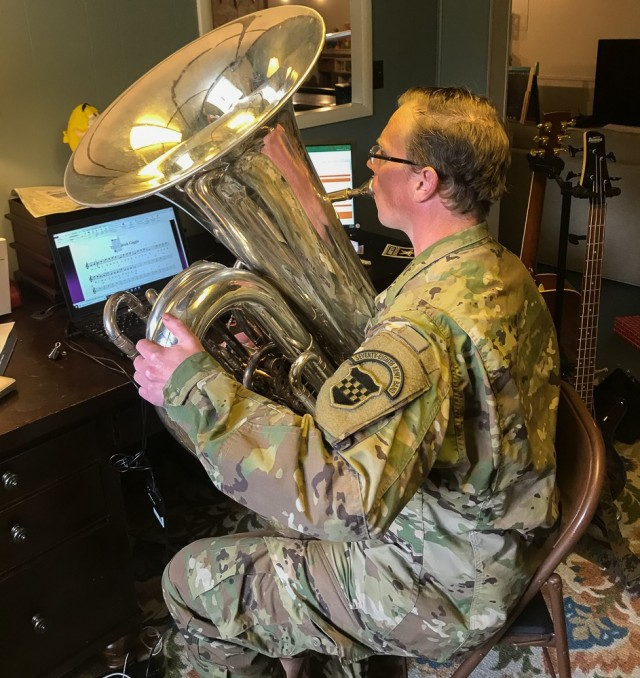 Sgt. 1st Class Tyrone Tedrick, tuba player for the 99th Readiness Division's 78th Army Band, leads a virtual master class on tuba fundamentals April 29, 2020. As COVID-19 pandemic social-distancing guidelines shuttered schools in March 2020 Tedrick and fellow band member Sgt. 1st Class Nicholas Greeson devised and created a fully interactive virtual music mentorship program for the quarantined elementary and high school students. In response to the ongoing pandemic, the 99th RD is spearheading several virtual initiatives to support the 45,000 Army Reserve Soldiers living and serving throughout the division's 13-state region stretching from Maine to Virginia.