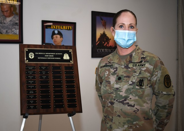 FORT DRUM, N.Y. – Lt. Col. Kristine Broger, the deputy commander for nursing, U.S. Army Medical Department Activity (MEDDAC), Fort Drum, N.Y., stands next to a plaque commemorating the MEDDAC's nationally board-certified nurses during the National Nurses Week kick-off celebration at the Guthrie Ambulatory Healthcare Clinic on Fort Drum, May 6.  (Photo by Warren W. Wright Jr., USA MEDDAC Fort Drum Public Affairs)