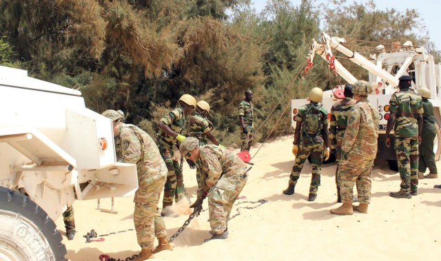 Combat advisors assigned to 1st Security Force Assistance Brigade's Logistics Advisor Team 1610, help train Senegalese soldiers on vehicle recovery operations March 12, 2020, in Dakar, Senegal.