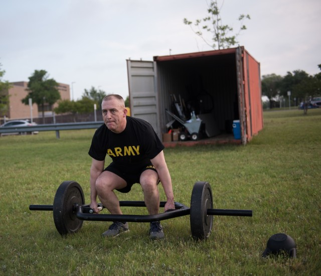 Command Sgt. Maj. Todd M. Garner, 13th Expeditionary Sustainment Command, focuses on the new Army Combat Fitness Test requirements.  During the COVID-19 pandemic, Soldiers and leaders are still able to maintain their physical readiness, while incorporating the recommended health of the force best practices. (U.S. Army photo by Sgt. 1st Class Kelvin Ringold)