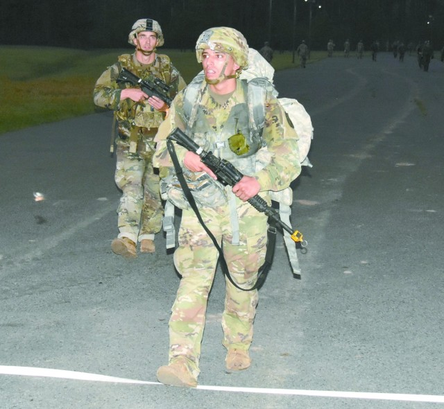 Two Soldiers approach the finish line of the 12-mile foot march March 27 at Fort Polk's Honor Field, finishing well within the 3-hour time limit.