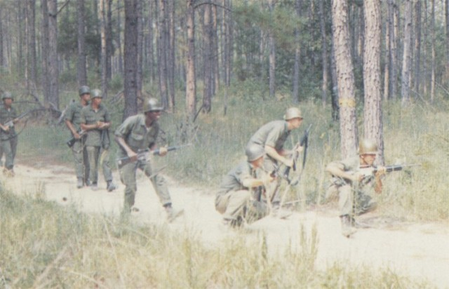 Soldiers with Delta Company, 1st Battalion, 1st Basic Combat Training Brigade, look for an ambush as they move out the the Fort Polk training area in April, 1974.