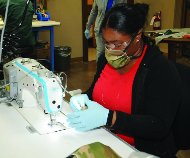Bridgett Walker, Carol Morris and Katherine Berry, all textile production workers with Pine Bluff Arsenal's Directorate of Chemical and Biological Defense Operations, make cloth face coverings for Soldiers and Civilians across Joint Munitions Command installations during the Army's COVID-19 response in March and April.