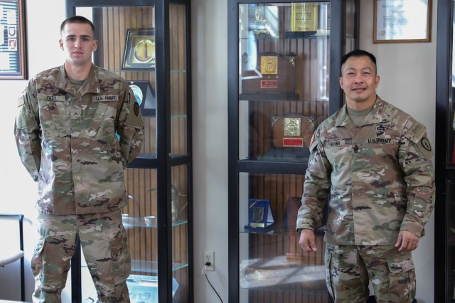Pvt. Drake Tutt, an infantryman with D Company, 2nd Battalion, 27th Infantry Regiment, 3rd Infantry Brigade Combat Team, 25th Infantry Division is presented a coin from Command Sgt. Maj. Thinh Huynh, the brigade's command sergeant major, at the Clovis Ray memorial conference room in the brigade's headquarters May 7, 2020 for upholding the Army values and displaying integrity during a tough situation.