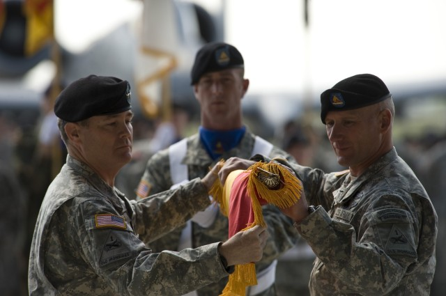 U.S. Army Maj. Gen. Terry A. Wolff (left), 1st Armored Division commander, and Command Sgt. Maj. William Johnson (right) case the division colors at a ceremony on Wiesbaden Army Airfield, Germany, May 13, 2011.  The event ended the division's 40-year history in Europe, which saw deployments to Desert Storm, Bosnia, Kosovo and Iraq.  (U.S. Air Force photo/TSgt Wayne Clark, AFNE Regional News Bureau) (Released)