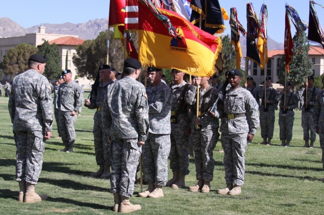 Fort Bliss, Texas – Gen. James D. Thurman, commanding general, U.S. Army Forces Command and Maj. Gen. Terry A. Wolff, 1st Armored Division, outgoing commander, stand before the 1st Armored Division colors as they fly for the first time on Fort Bliss during a color uncasing ceremony on May 24, 2011 at Noel Parade Field. The ceremony marked the official return of the division to U.S. soil after an absence of 40 years abroad in Germany and symbolized a significant moment in 1st Armored Division history. (U.S. Army photo by Daniela Vestal)