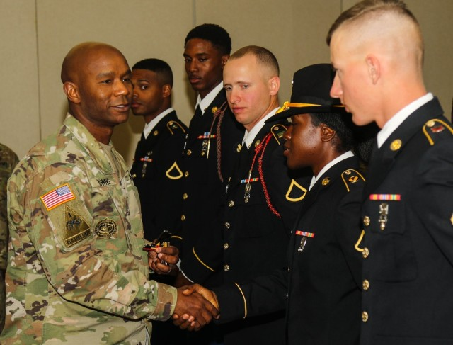 Command Sgt. Maj. Tony T. Towns, senior enlisted advisor with 1st Armored Brigade Combat Team, 1st Armored Division, congratulates all the junior enlisted Soldiers that competed in the Soldier of the Quarter Board at Fort Bliss, Texas, Nov. 1, 2019. Towns' experience with the Ready First Brigade's conversion from Stryker to Armored and the different armored units he served with, contributed to his selection as the next U.S. Army Armor School senior enlisted advisor. (U.S. Army photo by Staff Sgt. Kris Bonet)