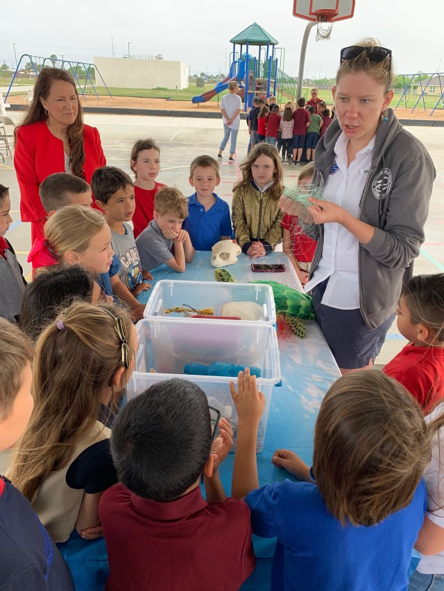 Corpus Christi Army Depot employees from the Environmental Program's Compliance Division support the first annual Earth Day festivities at Kolda Elementary School.  Presenters from the local area taught students about environmental stewardship as the Principal, Josie Alvarez, looks on.