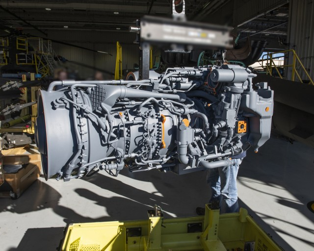 The 3D model of the General Electric T901 engine is lifted from its transportation canister in preparation for an AH-64E Apache fit check.  The team successfully completed the fit test on Jan. 28-29, 2020 in Mesa, AZ.