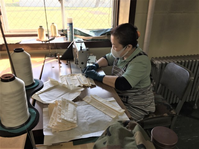 Kakizaki Mutsuko, lead sewer for the Japan Support Team, Army Field Support battalion-Northeast Asia, facemask fabrication effort, sews a mask. Her team has produced more than 1,700 of the coveted masks for USFJ. (Photo by Chief Warrant Officer 4 Brian Perinon, Japan Support Team, AFSBn-NEA)