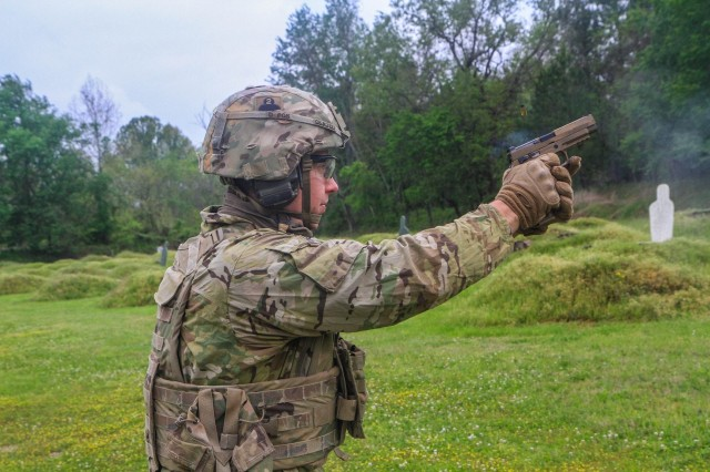 """U.S. Army Sgt. Joseph Kettley, an Infantryman assigned to 2nd Battalion, 327th Infantry Regiment """"No Slack"""", 1st Brigade Combat Team """"Bastogne"""", 101st Airborne Division (Air Assault), fires an  M17 pistol at the range on Fort Campbell, Ky., May 7. Soldiers from 2-327 Inf. Regt. qualified on their assigned weapons in preparation for the brigade's future deployment to Joint Readiness Training Center this fall at Fort Polk, La. (U.S. Army photo by Maj. Vonnie Wright)"""