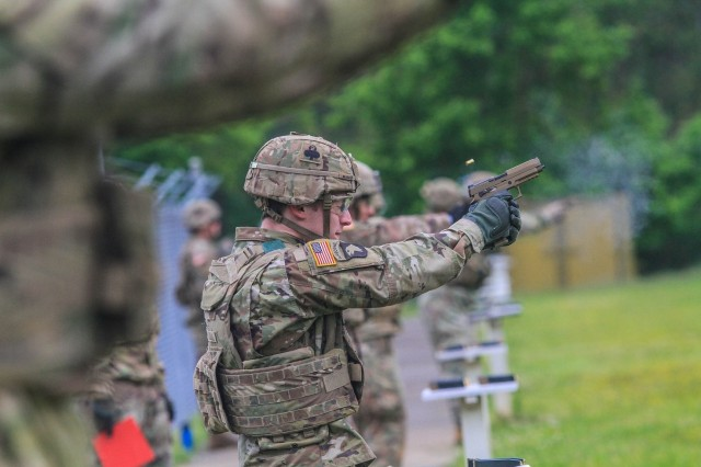 """Spc. Jacob Manha, an Infantryman assigned to 2nd Battalion, 327th Infantry Regiment """"No Slack"""", 1st Brigade Combat Team """"Bastogne"""", 101st Airborne Division (Air Assault), fires an M-17 pistol at a range on Fort Campbell, Ky., May 7. Soldiers from 2-327 Inf. Regt. qualified on their assigned weapons in preparation for the brigade's future deployment to Joint Readiness Training Center this fall at Fort Polk, La. (U.S. Army photo by Maj. Vonnie Wright)"""