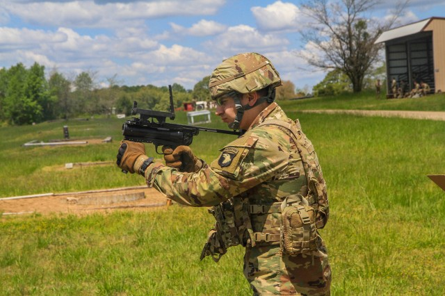 """Pvt. Morgan Potter, Company D., 2nd Battalion, 327th Infantry Regiment """"No Slack"""", 1st Brigade Combat Team """"Bastogne"""", 101st Airborne Division (Air Assault), fires an M-320 grenade launcher at a Fort Campbell, Ky. range, May 7. Soldiers from 2-327 Inf. Regt. qualified on their assigned weapons in preparation for the brigade's future deployment to Joint Readiness Training Center this fall at Fort Polk, La. (U.S. Army photo by Maj. Vonnie Wright)"""