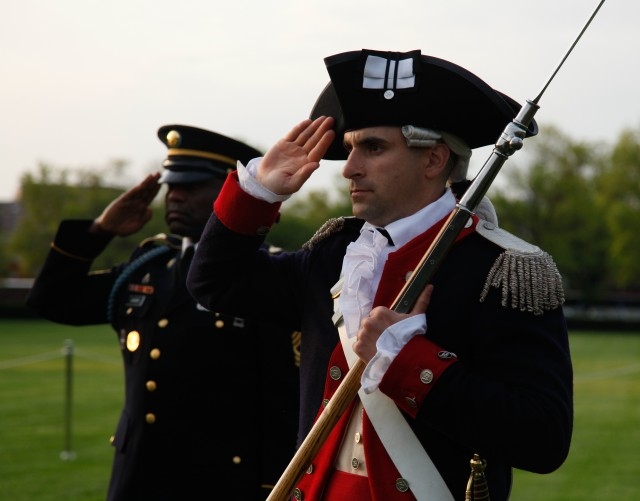 Capt. Thomas Sacchieri, the Commander-In-Chief's Guard company commander, 3d U.S. Infantry Regiment (The Old Guard), salutes during Twilight Tattoo at Summerall Field, Joint Base Myer-Henderson Hall, Va., May 7, 2014. The Old Guard conducts ceremonies and special events to represent the Army.
