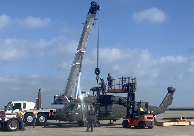 A UH-60L Black Hawk helicopter is loaded at Corpus Christi Army Depot in preparation for its trip to Wichita State University and the National Institute of Aviation Research (NIAR). A collaborative partnership that includes the Office of the Secretary of Defense, the Army and academia will create a virtual model of the work horse of Army aviation.