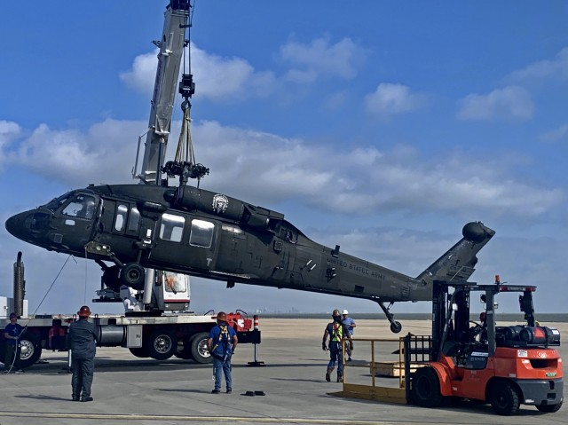 A UH-60L Black Hawk helicopter is prepared for shipment at Corpus Christi Army Depot for an 800-mile journey to Wichita State University where researchers at the National Institute of Aviation Research (NIAR) will create a virtual model of the work horse of Army aviation.