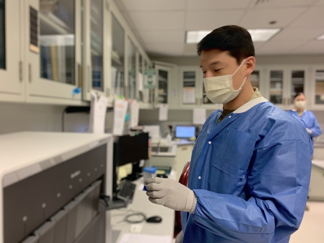 Spc. Daniel Sung works in the lab at Winn Army Community Hospital, May 16 on Fort Stewart. Since the onset of the coronavirus, the Winn Army Community Hospital laboratory has evolved services to help protect the force and community members by helping establish drive-up COVID-19 screening and testing sites, fever clinics, and by training and fielding new testing equipment. (Photo by Zach Rehnstrom)