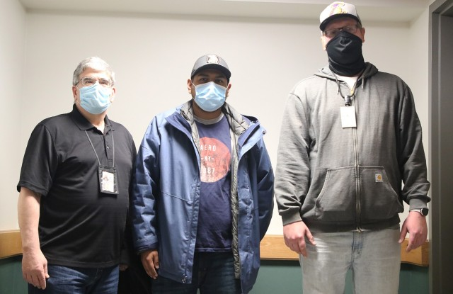 Sal Manteria (left), supervisor for Scott Barracks, Sergio Baquero, Directorate of Public Works custodial head manager for the barracks workforce, and Nate Workmann (right), overtime boss, have led the DPW custodial crew in cleaning the nine barracks buildings since late March. The nine barracks will be inhabited by the cadets when they return in cohorts starting Tuesday.