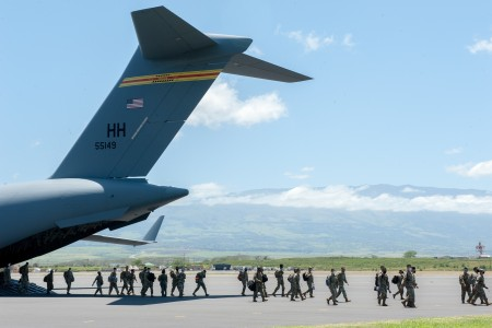 Hawaii Army National Guard Soldiers depart a C-17 Globemaster III April 17, 2020, at the Kahului Airport, Maui, Hawaii. The 204th Airlift Squadron transported hundreds of Airmen and Soldiers from Oahu to neighbor islands to assist with the COVID-19 response.