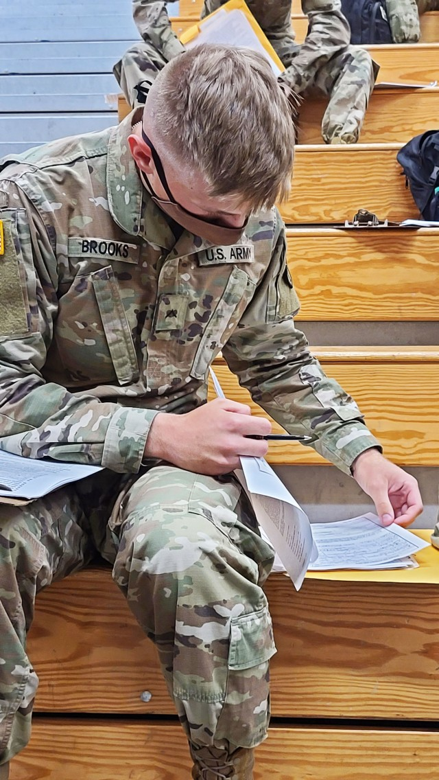Pvt. Curtis Brooks, an unmanned aircraft systems repairer who is newly assigned to the 3rd Infantry Division, fills out his in-processing paperwork after arriving at the Truscott Air Terminal at Hunter Army Airfield, Ga., May 13, 2020. Brooks just completed his advanced individual training at Fort Huachuca, Ariz. To maintain the health and safety of incoming personnel and those already stationed at Fort Stewart and Hunter, COVID-19 temperature screening checks were conducted on Brooks and the other incoming Soldiers before disembarking the aircraft. Other precautions implemented include maintaining social distancing, wearing face masks and regular hand washing throughout in-processing procedures. (U.S. Army photo by Sgt. Arjenis Nunez)