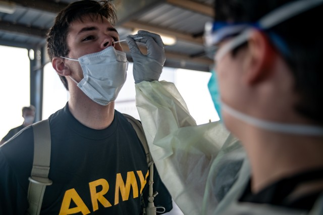 Preparing for Basic Combat Training, a trainee receives a COVID-19 nasal swab test. The check is administered to all trainees whether or not they report symptoms of the infection.