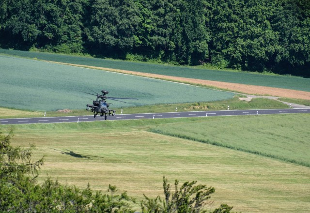 One of 18 AH-64 Apache helicopters moves into position during the 1-3rd Attack Reconnaissance Battalion (1-3rd ARB) exercise. The exercise was an opportunity for the 1-3rd ARB, to conduct a training mission May 19, with the full battalion under realistic conditions.