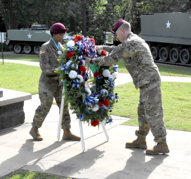 Sgt. 1st Class Adriana S. Fox, JRTC Operations Group and Audie Murphy Club member (left), and Brig. Gen. Patrick D. Frank, commander, JRTC and Fort Polk, place a wreath in front of the Global War on Terror memorial at Fort Polk's Warrior Memorial Park May 21 as part of the installation's Memorial Day Ceremony.