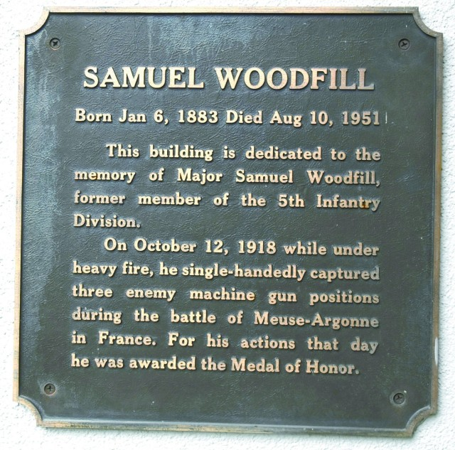 A plaque listing the exploits of Maj. Samuel Woodfill, 5th Infantry Division, is located near the entrance to Woodfill Hall.