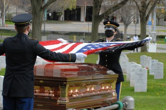 Honor Guard Soldiers provide socially distanced final salute