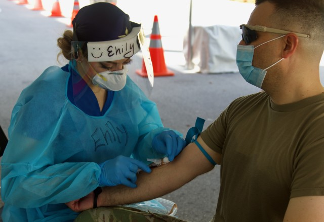 Florida National Guard Soldier Staff Sgt. Trinity Bierley has blood drawn for the COVID-19 antibody test at the Miami Beach Convention Center Community Based Testing Site in South Florida. The Florida Guard is providing support at the Miami Beach hybrid CBTS and Hard Rock Stadium CBTS to allow the state and local partners to conduct antibody testing for first responders at both facilities. (US Army photo by Sgt. Leia Tascarini)