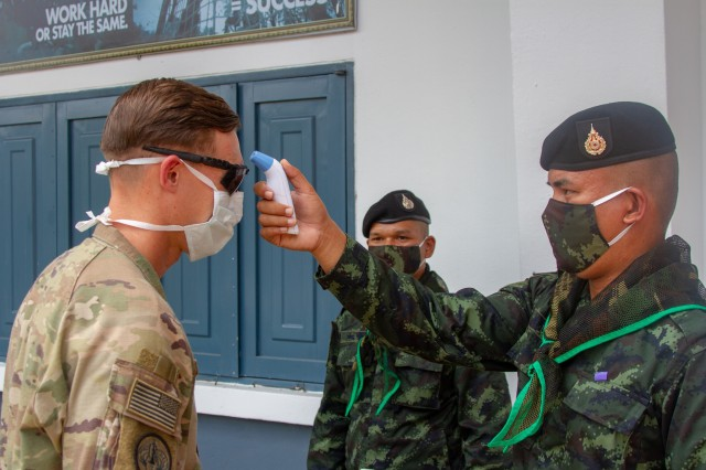 Capt. Andrew Borrebach, commander of Alpha Company, Task Force Cacti, 3rd Infantry Brigade Combat Team, 25th Infantry Division, gets his temperature checked as a preventative measure against COVID-19 on March 29, 2020, Krabi, Thailand, by Royal Thai Army medical personnel during the Hanuman Guardian exercise. U.S. Army Pacific plans to ramp up its Pacific Pathways exercises later this summer after being temporarily halted due to the COVID-19 pandemic.