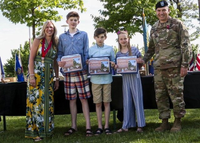 Col. William Glaser, chief of staff, 7th Army Training Command, poses for a picture with his wife and three kids after presenting his children with the Certificate of Appreciation for Little Ambassadors during the Service with Honor ceremony in Grafenwoehr, Germany, May 21, 2020. The Service with Honor ceremony, hosted by Brig. Gen. Christopher Norrie, commanding general, 7th ATC, was held to recognize senior leaders for their hard work and dedication while assigned to 7th ATC. (U.S. Army photo by Spc. Zack Stahlberg)