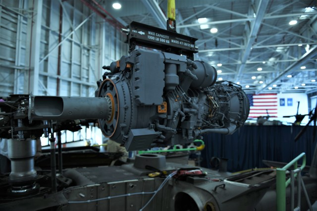 A 3D printed model of the GE T901 engine hangs from its sling waiting to be installed in an H-60M Black Hawk at Sikorsky's West Palm Beach, FL facility.