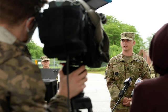 Master Sgt. David Royer, 705th Military Police Battalion (Detention), recounts to area media, including Fox 4 photojournalist John Gerhards and reporter Sherae Honeycutt, how he subdued an active shooter the day before on Centennial Bridge during a press conference May 28 at Sherman Gate. Photo by Prudence Siebert/Fort Leavenworth Lamp