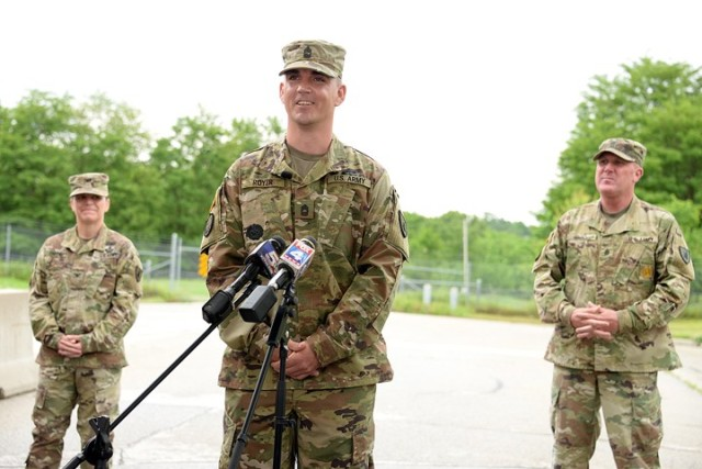 Master Sgt. David Royer, 705th Military Police Battalion (Detention), supported by 15th MP Brigade Commander Col. Caroline Smith and 705th MP Battalion Command Sgt. Maj. Justin Shad, speaks to area reporters about taking action to subdue an active shooter the day before on Centennial Bridge in Leavenworth during a press conference May 28 at Sherman Gate.