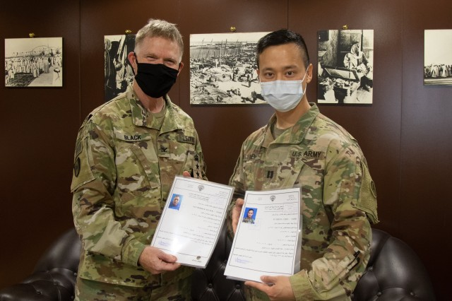 U.S. Army Col. Ian Black and Capt. Yusheng Chen