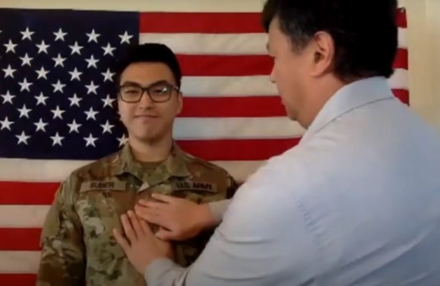 U.S. Army 2nd Lt. Daniel Suber is pinned with his new rank by a family member during a virtual commissioning ceremony for graduates of the University of Southern California Army ROTC program May 16, 2020. Photo is a screenshot taken from video. (U.S. Army photo courtesy of University of Southern California Army ROTC)