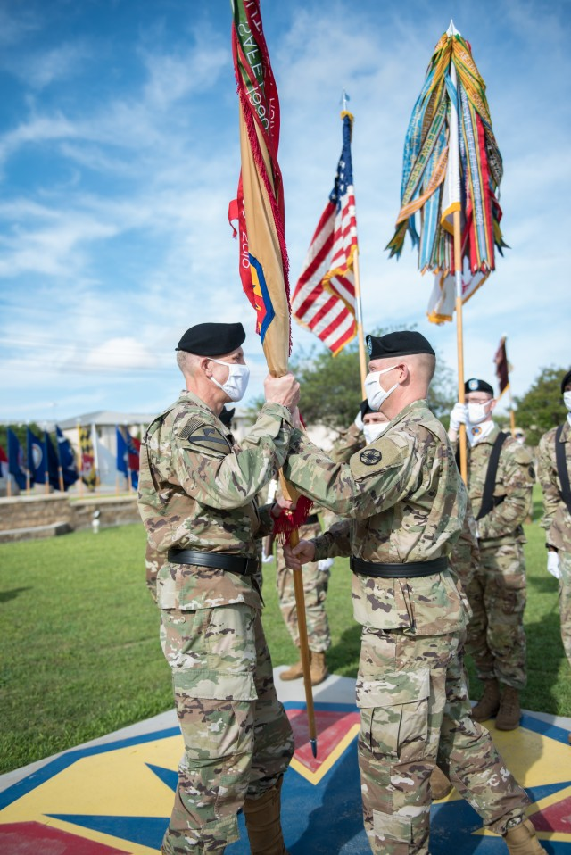 Outgoing Commanding General, Brig. Gen. Darren L. Werner, passes the colors to Maj. Gen. Scott Efflandt, Deputy Commanding General, III Corps and Fort Hood, during the ceremony May 29. Werner will now head to Michigan as the Commanding General for the U.S. Army Tank-Automotive and Armaments Command. (U.S. Army photo by Sgt. 1st Class Kelvin Ringold)