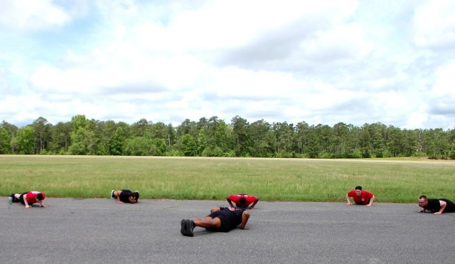 Sgt. Martin Fane, 46th Engineer Battalion, does push ups with his squad. Pictured, from left to right: Pfc. Preston Brown, Pfc. Quinton Smith, Spc. Ronald Jones, Pvt. Joel Hensley and Pvt. Don Govero. Fane is in the center of the formation.