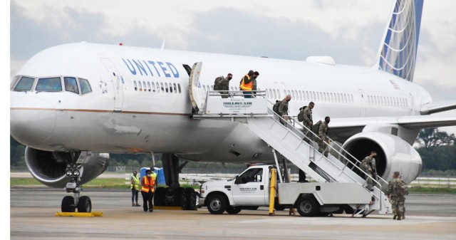 The 4th Security Force Assistance Brigade, from Fort Carson, Colorado, deplane at the Alexandria International airport May 26.