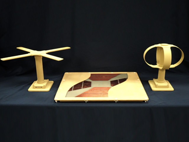 A new metaferrite antenna (center) replaces the X-wing antenna (left) and the egg beater antenna (right).