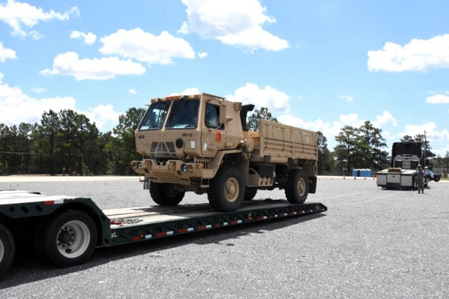 Soldiers for 4th SFAB  retrieve a vehicle from the centralized receiving and shipping point on Fort Polk.