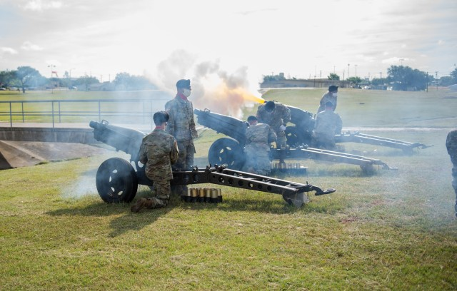 Battery C, 1st Battalion, 82nd Field Artillery Regiment, 1st Armored Brigade Combat Team, fires the cannons during the 13th Expeditionary Sustainment Command's change-of-command ceremony. Brig. Gen. Darren L. Werner, outgoing 13th ESC Commanding General, relinquished command to Col. (P) Ronald R. Ragin during a ceremony on Brig. Gen. Terrance J. Hildner Field May 29. (U.S. Army photo by Sgt. 1st Class Kelvin Ringold)
