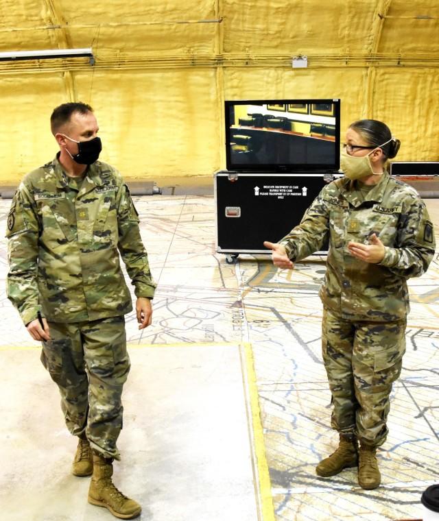 Maj. Sarah Jones, JRTC SOC (left), converses with Maj. Edwin Bodenheim, 4th SFAB executive officer.