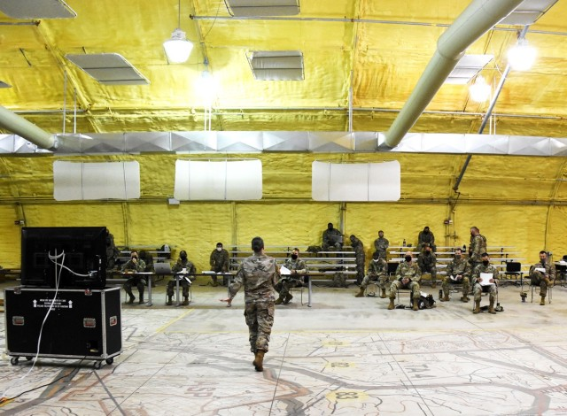 Maj. Sarah Jones, Joint Readiness Training Center Sustainment Operations Center, conducts a reception, staging, onward movement and integration rehearsal briefing for 4th SFAB Soldiers on May 27.